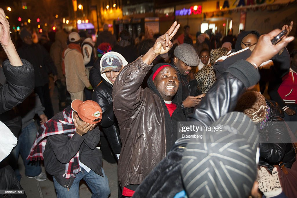 Democratic supporters celebrate after U.S. President Barack Obama was projected the winner of the presidential election in the Harlem neighborhood of New York, U.S., early on Wednesday, Nov. 7, 2012. Obama, the post-partisan candidate of hope who became the first black U.S. president, won re-election today by overcoming four years of economic discontent with a mix of political populism and electoral math. Photographer: Michael Nagle/Bloomberg via Getty Images