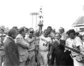 Democratic Team Manager Bill Chappell and Mendel Davis hold the Roll Call trophy after winning the Congressional Baseball Game of 1975 Speaker Carl...