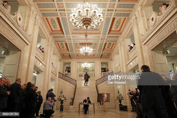 Democratic Union Party Leader Arlene Foster signs a book of condolence at Stormont on March 22 2017 in Belfast Northern Ireland Northern Ireland's...