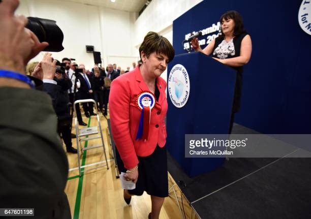 Democratic Unionist party leader and former First Minister Arlene Foster exits the stage after making her speech watched by Michelle Gildernew of...
