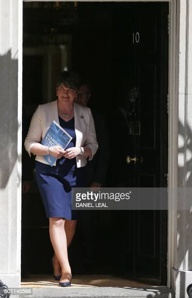 Democratic Unionist Party leader Arlene Foster addresses the media outside 10 Downing Street in central London on June 26 following her meeting with...