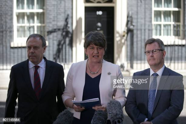 Democratic Unionist Party leader Arlene Foster addresses the media flanked by DUP Deputy Leader Nigel Dodds and DUP MP Jeffrey Donaldson outside 10...