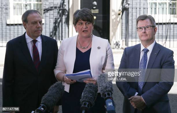 Democratic Unionist Party leader Arlene Foster addresses the media flanked by DUP Deputy Leader Nigel Dodds and DUP MP Jeffrey Donaldson outside 10...