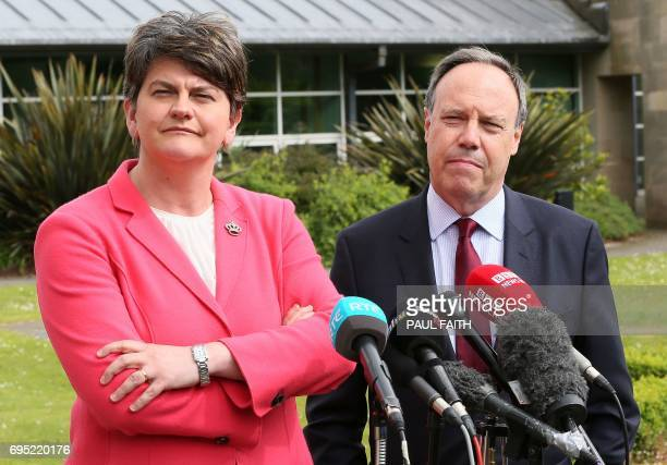 Democratic Unionist Party leader Arlene Foster and DUP Deputy Leader Nigel Dodds prepare to address the media outside Stormont Castle on the Stormont...