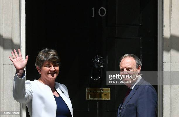 Democratic Unionist Party leader Arlene Foster and DUP Deputy Leader Nigel Dodds arrive at 10 Downing Street in central London on June 13 for a...