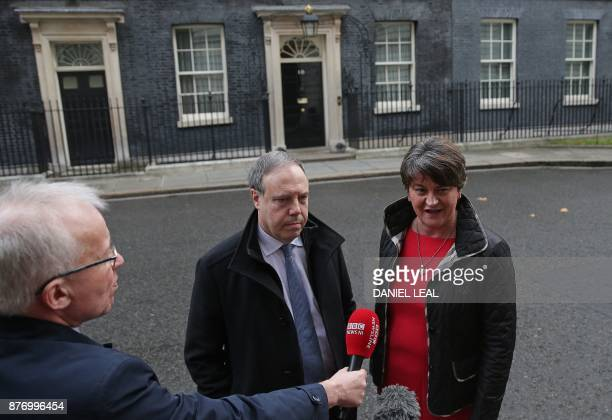 Democratic Unionist Party leader Arlene Foster and DUP Deputy Leader Nigel Dodds address the media outside 10 Downing Street in central London on...