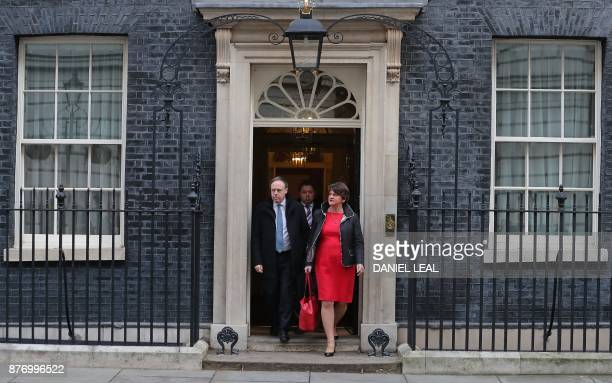 Democratic Unionist Party leader Arlene Foster and DUP Deputy Leader Nigel Dodds react as they leave 10 Downing Street in central London on November...