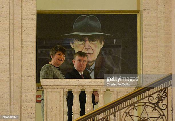Democratic Unionist Party leader Arlene Foster walks past a painting of Ian Paisley at Stormont on January 11 2016 in Belfast Northern Ireland Arlene...