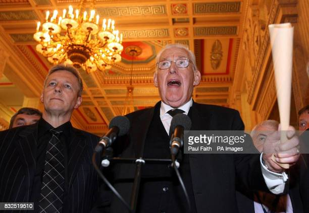 Democratic Unionist Party leader Rev Ian Paisley speaks to the press at Stormont while deputy leader Peter Robinson listens after Mr Paisley's...