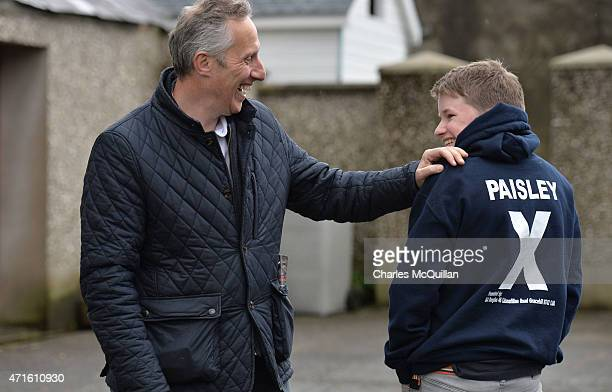 Democratic Unionist Party Westminster candidate Ian Paisley Jr jokes with a young election worker whilst out canvassing on April 29 2015 in...