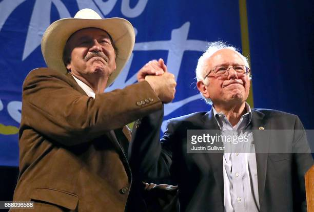 Democratic US Congressional candidate Rob Quist and US Sen Bernie Sanders greet supporters during a campaign rally on May 20 2017 in Butte Montana...