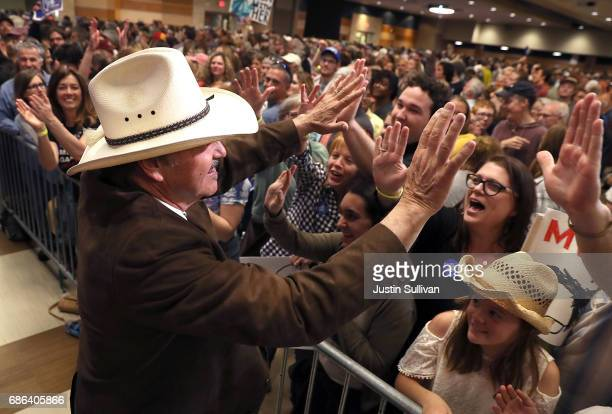 Democratic US Congressional candidate Rob Quist greets supporters during a campaign rally with US Sen Bernie Sanders on May 21 2017 in Bozeman...