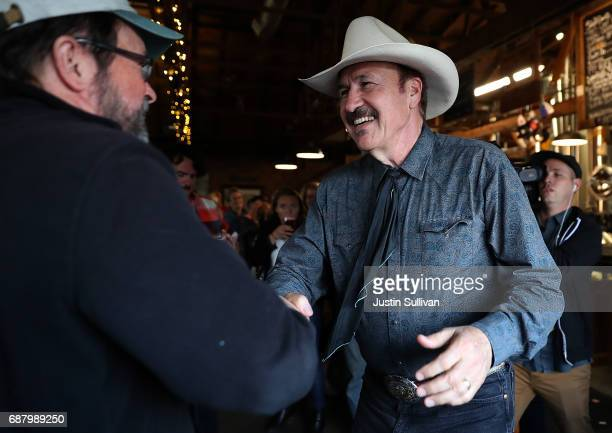 Democratic US Congressional candidate Rob Quist greets supporters during a campaign rally at Draught Works Brewery on May 24 2017 in Missoula Montana...