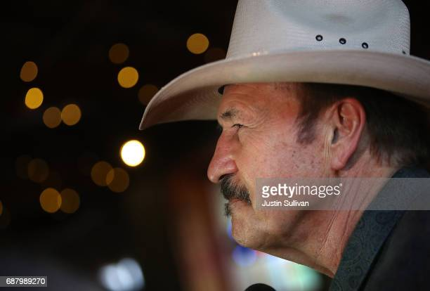 Democratic US Congressional candidate Rob Quist looks on during a campaign rally at Draught Works Brewery on May 24 2017 in Missoula Montana Rob...