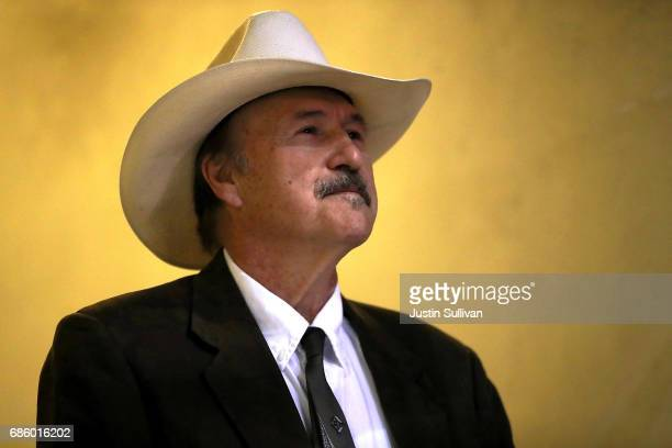 Democratic US Congressional candidate Rob Quist looks on from backstage before the start of a campaign rally with US Sen Bernie Sanders at the...