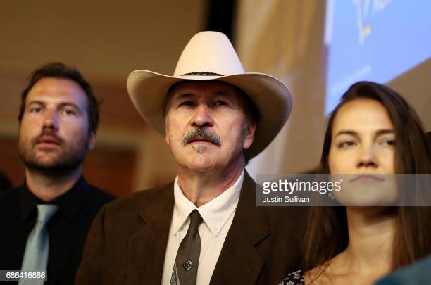 Democratic US Congressional candidate Rob Quist looks on with his daughter Halladay Quist and son Guthrie Quist during a campaign rally with US Sen...