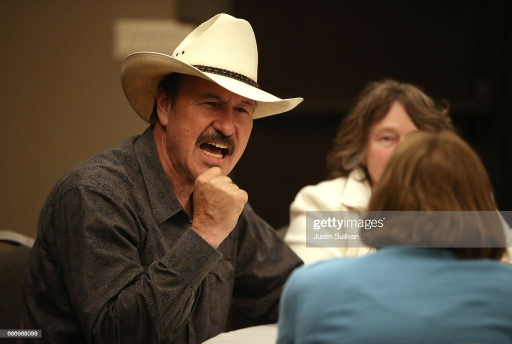 Democratic U.S. Congressional candidate Rob Quist talks with supporters during a gathering at Darkhorse Hall and Wine Snug on May 22, 2017 in Great Falls, Montana. Rob Quist is campaigning throughout Montana ahead of a May 25 special election to fill Montana's single congressional seat. Quist is in a tight race against republican Greg Gianforte.