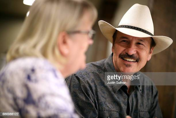 Democratic US Congressional candidate Rob Quist talks with supporters during a gathering at Darkhorse Hall and Wine Snug on May 22 2017 in Great...