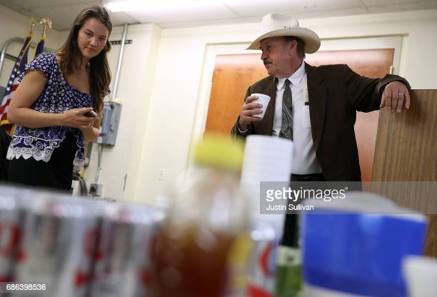 Democratic US Congressional candidate Rob Quist waits backstage with his daughter Halladay Quist before the start of a campaign rally with US Sen...