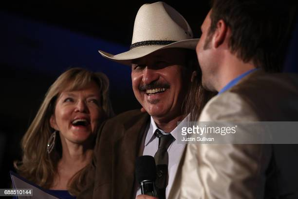 Democratic US Congresstional candidate Rob Quist delivers his concession speech to supporters as his wife Bonni Quist looks on at the DoubleTree by...