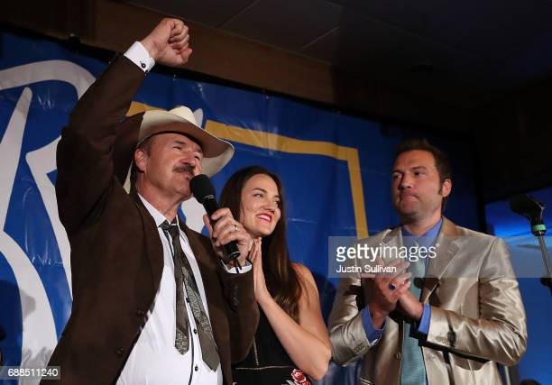 Democratic US Congresstional candidate Rob Quist delivers his concession speech to supporters as his son Guthrie Quist and daughter Halladay Quist...