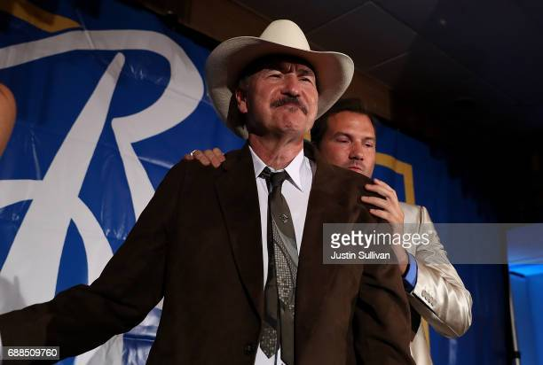 Democratic US congresstional candidate Rob Quist is embraced by his son Guthrie Quist after dlivering his concession speech to supporters at the...