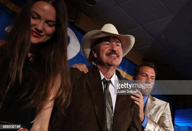 Democratic US Congresstional candidate Rob Quist is is surrounded by his son Guthrie Quist and daughter Halladay Quist after dlivering his concession...
