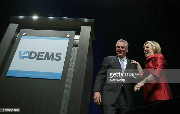 Democratic US presidential hopeful and former US Secretary of the State Hillary Clinton and Virginia Governor Terry McAuliffe share a moment during...
