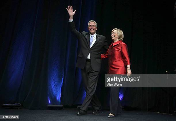 Democratic US presidential hopeful and former US Secretary of the State Hillary Clinton comes on the stage with Virginia Governor Terry McAuliffe...