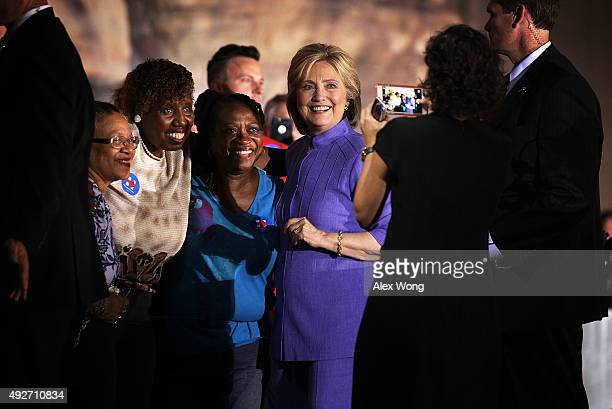 Democratic US presidential hopeful Hillary Clinton poses for photos with supporters during a campaign rally October 14 2015 in Las Vegas Nevada...