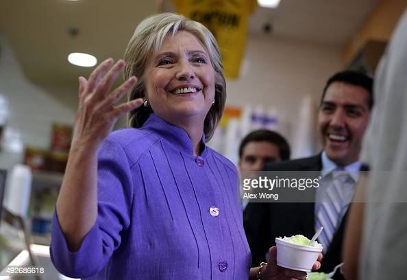 Democratic US presidential hopeful Hillary Clinton reacts to questions from members of the media as she visits La Flor De Michoacan Ice Cream October...