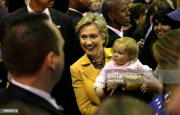 Democratic US presidential hopeful Sen Hillary Clinton holds a baby during a town hall meeting at Grace E Metz Middle School February 10 2008 in...