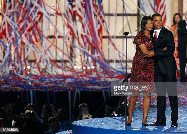 Democratic US Presidential nominee Sen Barack Obama hugs his wife Michelle Obama after his speech on day four of the Democratic National Convention...