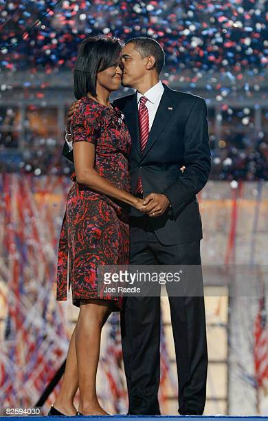 Democratic US Presidential nominee Sen Barack Obama kisses his wife Michelle Obama after his speech on day four of the Democratic National Convention...