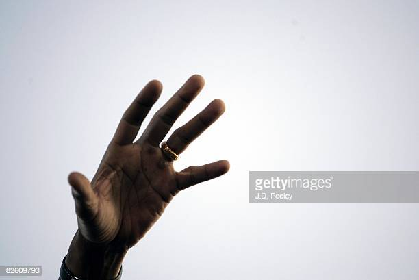 Democratic US presidential nominee Sen Barack Obama's hand stretches out as he speaks to a crowd with his running mate Democratic US vicepresidential...