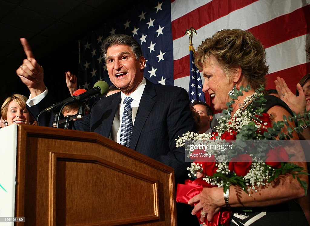 Democratic U.S. Senate candidate and West Virginia Governor <a gi-track='captionPersonalityLinkClicked' href=/galleries/search?phrase=Joe+Manchin&family=editorial&specificpeople=568465 ng-click='$event.stopPropagation()'>Joe Manchin</a> (L) celebrates as his wife Gayle (R) looks on during a election night victory party November 2, 2010 in Charleston, West Virginia. Manchin has won the senate seat that was held by the late Sen. Robert Byrd (D-WV) by defeating Republican challenger John Raese.