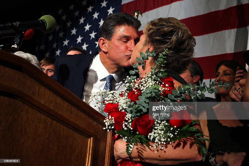 Democratic U.S. Senate candidate and West Virginia Governor <a gi-track='captionPersonalityLinkClicked' href=/galleries/search?phrase=Joe+Manchin&family=editorial&specificpeople=568465 ng-click='$event.stopPropagation()'>Joe Manchin</a> (L) celebrates as he kisses his wife Gayle (R) during a election night victory party November 2, 2010 in Charleston, West Virginia. Manchin has won the senate seat that was held by the late Sen. Robert Byrd (D-WV) by defeating Republican challenger John Raese.