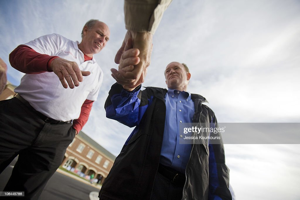 Democratic U.S. Senate Candidate Chris Coons (R) and State Representative Pete Schwartzkopf (L) greet voters outside of the polls at Cape Henlopen High School November 2, 2010 in Lewes, Delaware. Coons is running against Republican nominee and Tea Party favorite Christine O'Donnell.