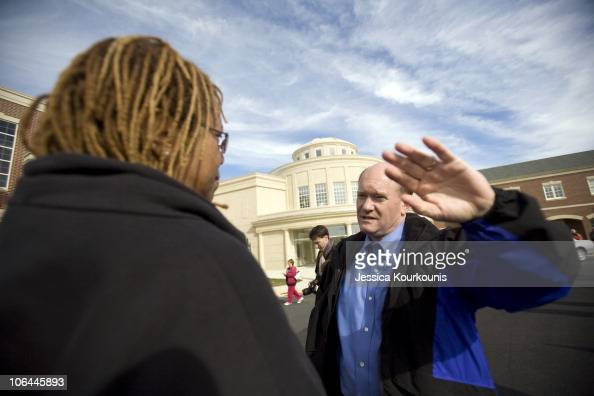 Democratic US Senate candidate Chris Coons greets voters outside of the polls at Cape Henlopen High School November 2 2010 in Lewes Delaware Coons is...