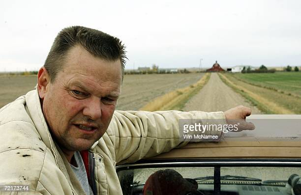 Democratic US Senate candidate Jon Tester rides in the back of his pickup truck while working on his farm October 15 2006 in Big Sandy Montana Tester...