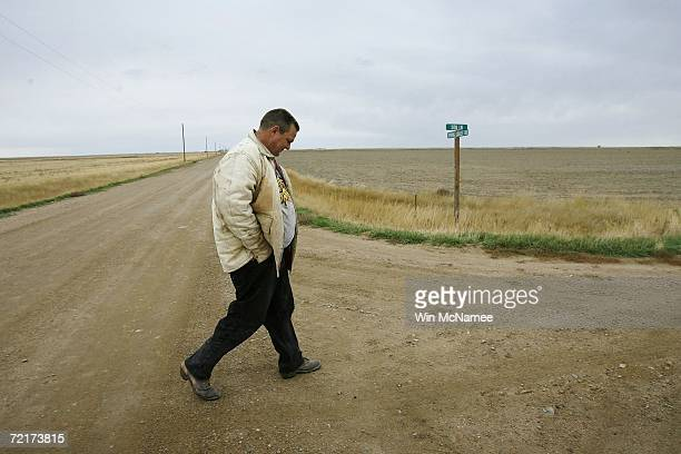 Democratic US Senate candidate Jon Tester walks down the road while working on his farm October 15 2006 in Big Sandy Montana Tester a third...