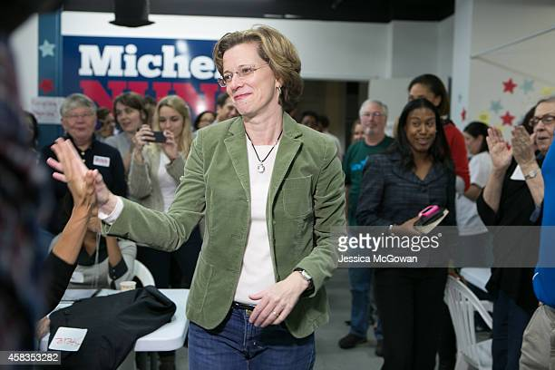 Democratic US Senate candidate Michelle Nunn greets and thanks phone bank volunteers on the eve of the midterm election at her campaign headquarters...