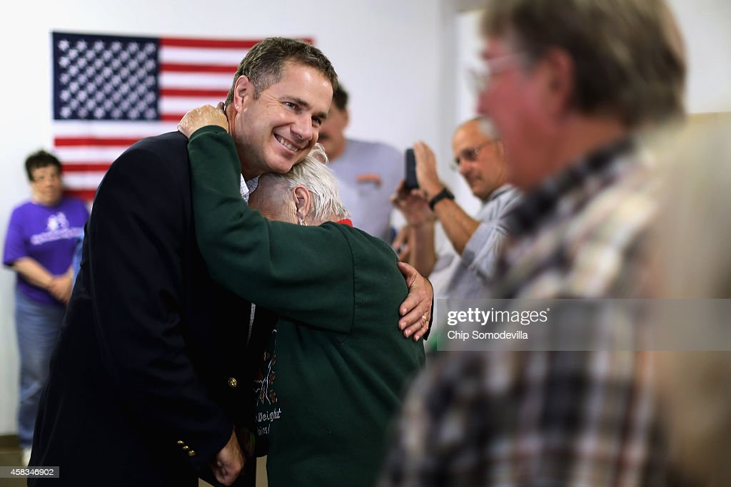Democratic U.S. Senate candidate Rep. Bruce Braley (D-IA) (L) hugs volunteer Pat Halferty during a campaign stop at the Lynn Count Democratic Headquarters November 3, 2014 in Cedar Rapids, Iowa. According to the polls, Braley is in a neck-and-neck race with his opponent, Republican Joni Ernst, and the election in Iowa could decide which party controls the U.S. Senate.
