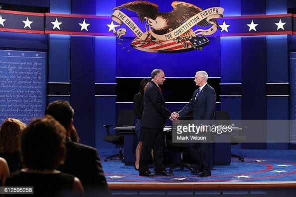 Democratic vice presidential nominee Tim Kaine and Republican vice presidential nominee Mike Pence shake hands prior to the start of the Vice...