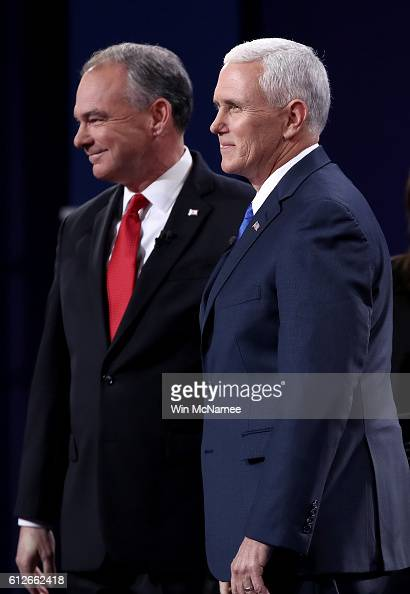 Democratic vice presidential nominee Tim Kaine and Republican vice presidential nominee Mike Pence listen stand on stage prior to the Vice...
