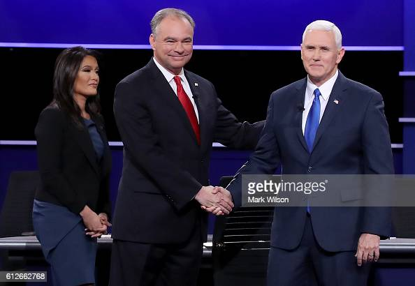Democratic vice presidential nominee Tim Kaine and Republican vice presidential nominee Mike Pence shake hands on stage as debate moderator Elaine...