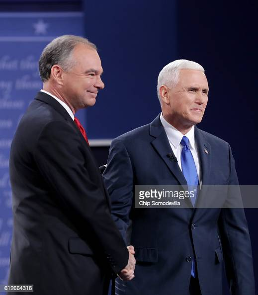 Democratic vice presidential nominee Tim Kaine and Republican vice presidential nominee Mike Pence shake hands on stage prior to the Vice...