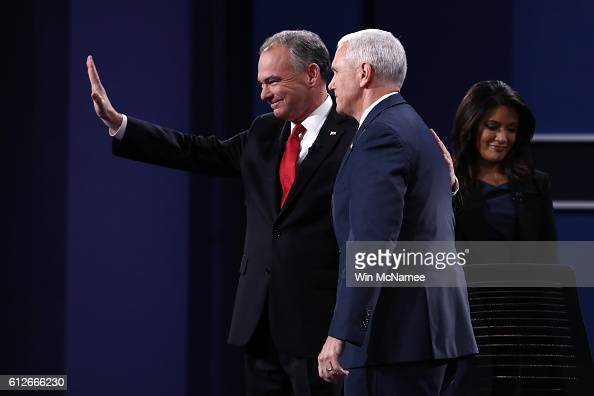 Democratic vice presidential nominee Tim Kaine and Republican vice presidential nominee Mike Pence stand on stage as debate moderator Elaine Quijano...