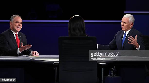 Democratic vice presidential nominee Tim Kaine and Republican vice presidential nominee Mike Pence speak as debate moderator Elaine Quijano listens...