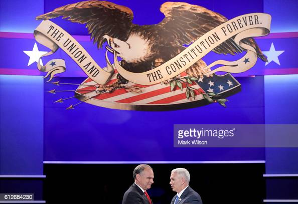 Democratic vice presidential nominee Tim Kaine and Republican vice presidential nominee Mike Pence shake hands following the Vice Presidential Debate...